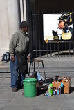 Shoe shine vendor Stock Images