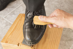 Shoe shiner brushing a businessman shoe Royalty Free Stock Photography