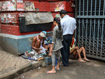 Shoe shiner does his job at street of Kolkata Stock Photography