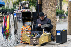 Shoe shiner in Kosovo Royalty Free Stock Image