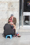 Shoe shiner in Madrid, Spain Royalty Free Stock Photography