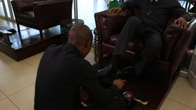 Shoe shining stock video footage