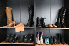 Shoe shop. Boots collection on shelves Stock Photo