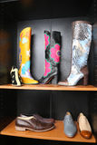 Shoe shop. Boots collection on shelves Royalty Free Stock Photos