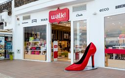 Shoe shop in Lanzarote. Lanzarote, the Canary Islands, Spain, 2017: big red shoe at the entrance to the Walk shoe shop. Brand name shoes Stock Images