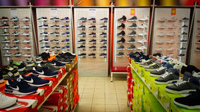 Shoe shop. Shelves with many sneakers. Stock Photography