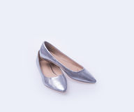 Shoe. Silver colour fashion woman shoes on a background. Royalty Free Stock Images