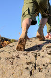 Shoe Sole of a Boy Scout Climbing a Rock Stock Photo