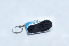 Shoe soles of blue sneeaker key chain isolated on white backgrou Royalty Free Stock Photography