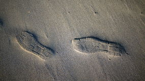 Shoe Step on Sand. Shoe step mark on sand beach at Wetar Island, Maluku, Indonesia royalty free stock photos
