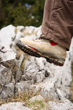 Shoe is stepping on a rock. White Hiking shoe is just about to step on a rock on a mountain Royalty Free Stock Photo