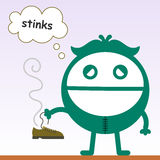 Shoe stinks. A sad business man with a bad smelling shoe Stock Images