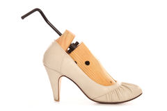Shoe stretcher in high heels. Cutout Stock Image