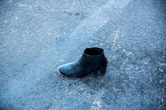 A shoe survives a massacre. Las Vegas, NV. Oct.2, 2017: A lost shoe is all that remains of a victim at the triage point in the Mandalay Bay massacre Royalty Free Stock Images