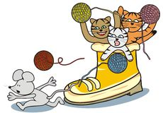 Shoe. Three cheerful kittens throwing a ball mouse. Amusing picture Royalty Free Stock Image