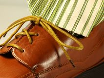Shoe and Tie. Brown shoe with matching tie with brown stripes Stock Photos