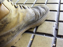 A shoe on tiles Royalty Free Stock Image