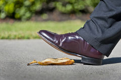 Shoe About to Step on Banana Peel Royalty Free Stock Photography