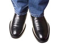 Shoe under jeans Royalty Free Stock Images
