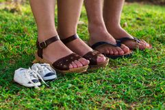 Feet of pregnant woman, husband and son shoe stock photos