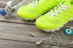 Shoe, water and headphones Royalty Free Stock Images