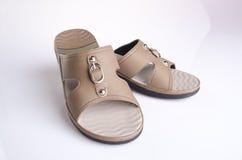 Shoe. woman sandal on background. woman sandal on a background. Shoe. woman sandal on background. woman sandal on a background Royalty Free Stock Image