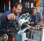 Shoe worker Royalty Free Stock Images