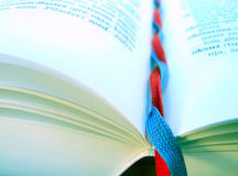 Shoelace bookmarks. Red and blue shoelace bookmarks and book stock photos
