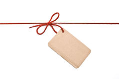 Shoelace with cardboard tag. Red shoelace,bow with cardboard tag Royalty Free Stock Photo