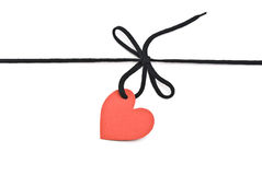 Shoelace with tag. Black shoelace,bow with red tag heart Royalty Free Stock Photos