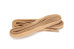 Shoelaces. A pair of beige shoelaces isolated on a white background royalty free stock photography