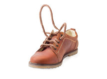 Shoelaces on brown mens shoe during lacing Royalty Free Stock Image