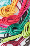 Shoelaces of different colors, knotted, on white Royalty Free Stock Image