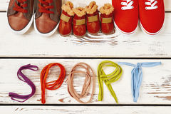 Shoelaces and family sport shoes. Royalty Free Stock Images