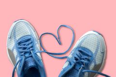 Shoelaces with heart sign, love sport concept. Shoelaces with heart sign, love sport concept on pink background Stock Photography