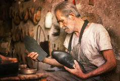 Shoemaker. In his street shop, Iran. Film scan royalty free stock photography