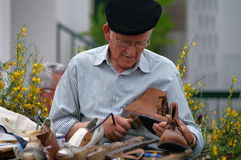 Shoemaker. Ancient shoemaker showing his skills in public (Salir, Portugal stock photo