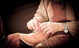 Shoemaker. Detail of the hands of a Shoemaker, manufacturing boots royalty free stock images