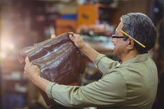 Shoemaker examining a piece of leather Stock Image