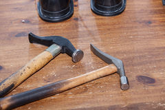 Shoemaker hammers. Old tools on table stock image