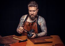 Shoemaker makes artisan shoes with old tools. For leather working royalty free stock image