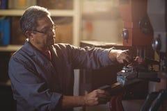 Shoemaker making shoe on machine. In workshop Stock Images