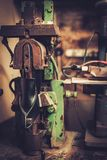 Shoemaker performs shoes in studio craft professional  machines. Royalty Free Stock Image