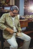 Shoemaker repairing a high heel. In workshop Royalty Free Stock Photos