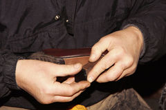 Shoemaker is repairing leather shoe. Royalty Free Stock Photos