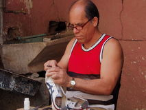 The Shoemaker Royalty Free Stock Image