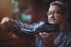 Shoemaker repairing a shoe. In workshop Royalty Free Stock Images