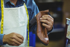 Shoemaker repairing a shoe. In workshop Royalty Free Stock Photo