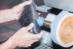Shoemaker repairs a shoe Stock Photos