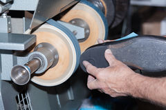 Shoemaker repairs a shoe. The shoemaker repairs a shoe stock images